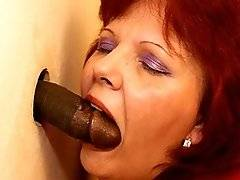 interracial mom fucking movies - This mature slut loves a cock on the gloryhole toilet